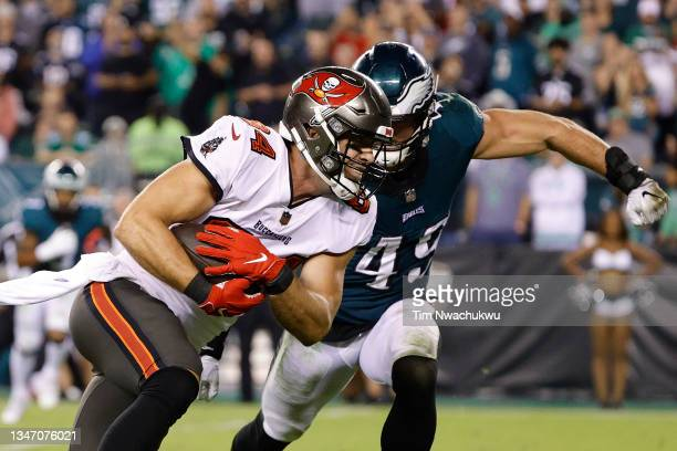 Cameron Brate of the Tampa Bay Buccaneers makes a reception past Alex Singleton of the Philadelphia Eagles at Lincoln Financial Field on October 14,...
