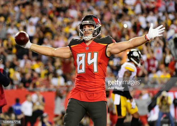 Cameron Brate of the Tampa Bay Buccaneers reacts after scoring in the first quarter against the Pittsburgh Steelers on September 24, 2018 at Raymond...
