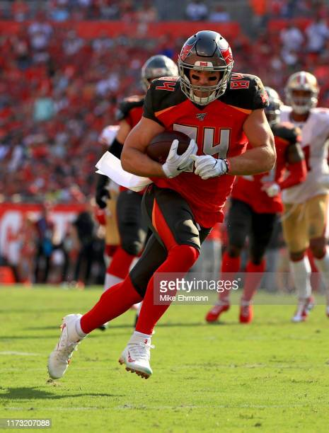 Cameron Brate of the Tampa Bay Buccaneers runs after a catch during a game against the San Francisco 49ers at Raymond James Stadium on September 08,...