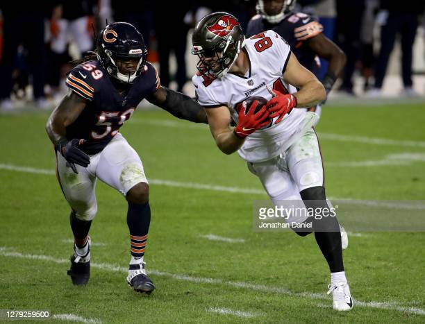 Cameron Brate of the Tampa Bay Buccaneers runs with the ball while being chased by Danny Trevathan of the Chicago Bears in the fourth quarter at...