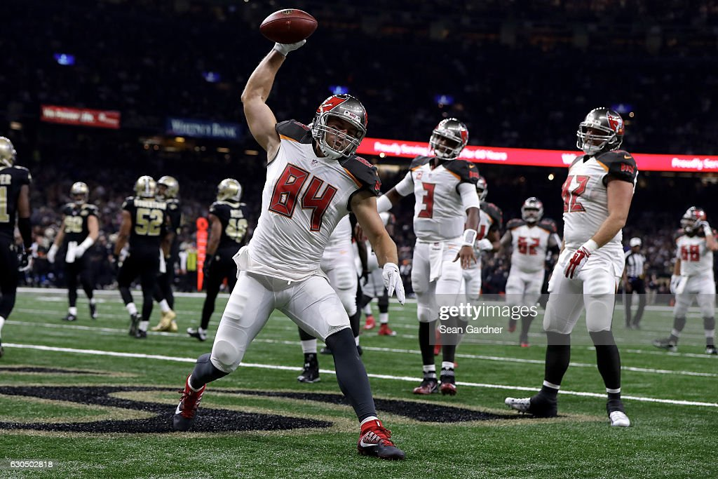 Cameron Brate #84 of the Tampa Bay Buccaneers scores a touchdown against the New Orleans Saints at the Mercedes-Benz Superdome on December 24, 2016 in New Orleans, Louisiana.