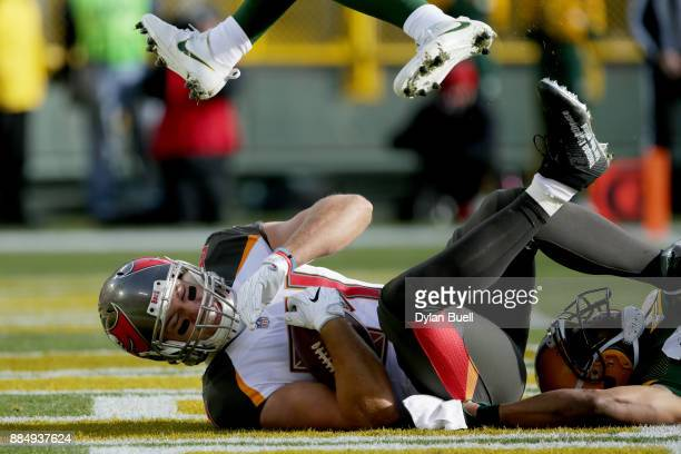 Cameron Brate of the Tampa Bay Buccaneers scores a touchdown in the first quarter against the Green Bay Packers at Lambeau Field on December 3 2017...