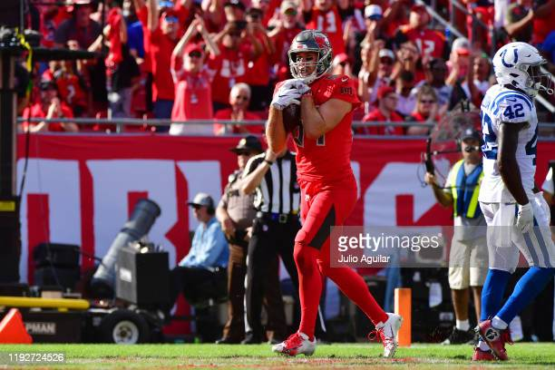 Cameron Brate of the Tampa Bay Buccaneers scores on a 3-yard reception thrown by Jameis Winston during the second quarter of a football game against...