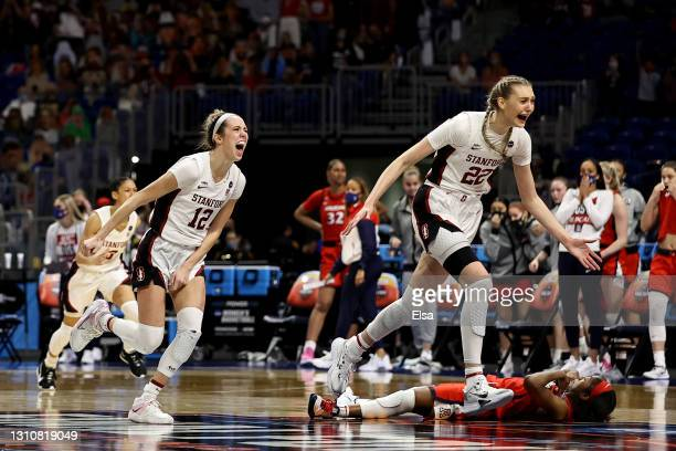 Cameron Brink of the Stanford Cardinal and Lexie Hull of the Stanford Cardinal celebrate a win against the Arizona Wildcats in the National...
