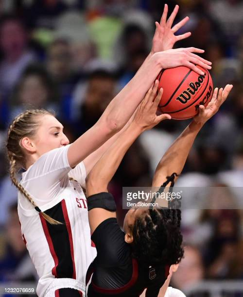Cameron Brink of the Stanford Cardinal blocks the shot attempt of Zia Cooke of the South Carolina Gamecocks during the semifinals of the NCAA Women's...