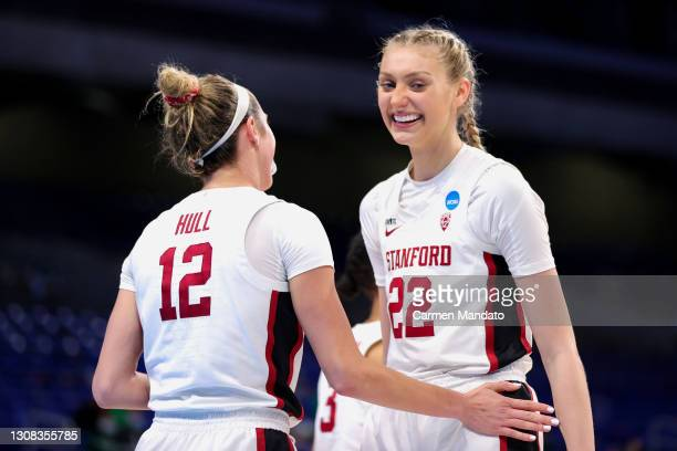 Cameron Brink of the Stanford Cardinal reacts Lexie Hull after a basket against the Utah Valley Wolverines during the second half in the first round...
