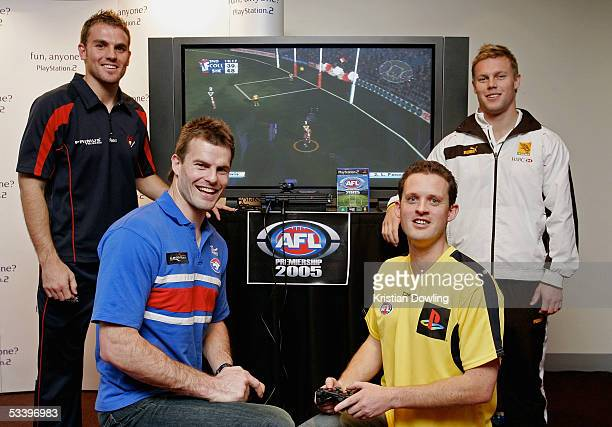 Cameron Bruce from the Melbourne Demons Luke Darcy from the Western Bulldogs Umpire Shane McInerney and Sam Mitchell from the Hawthorn Hawks attend...