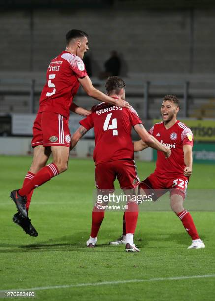 Cameron Burgess of Accrington Stanley celebrates with team mates during the Carabao Cup First Round match between Burton Albion and Accrington...