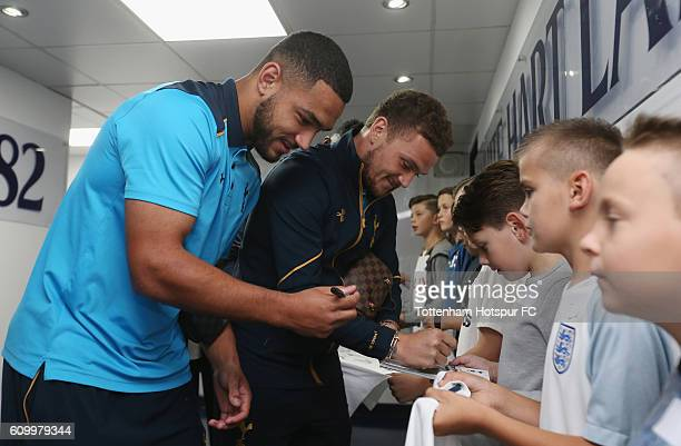 Cameron Carter-Vickers and Kieran Trippier sign autographs for mascots during the EFL Cup Third Round match between Tottenham Hotspur and Gillingham...