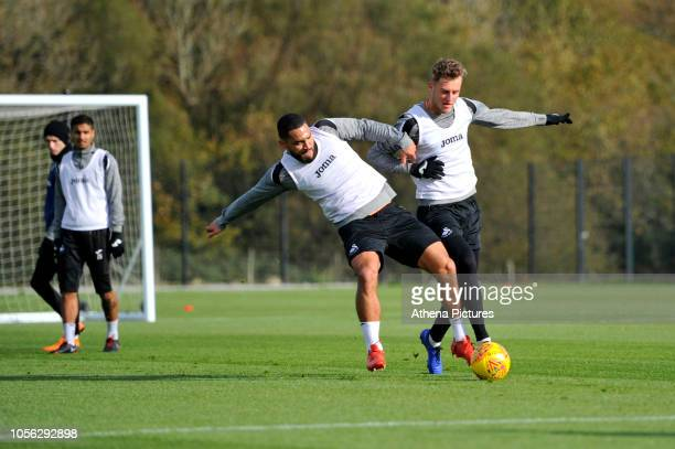 Cameron CarterVickers battles with Joe Rodon of Swansea City during the Swansea City Training at The Fairwood Training Ground on October 31 2018 in...