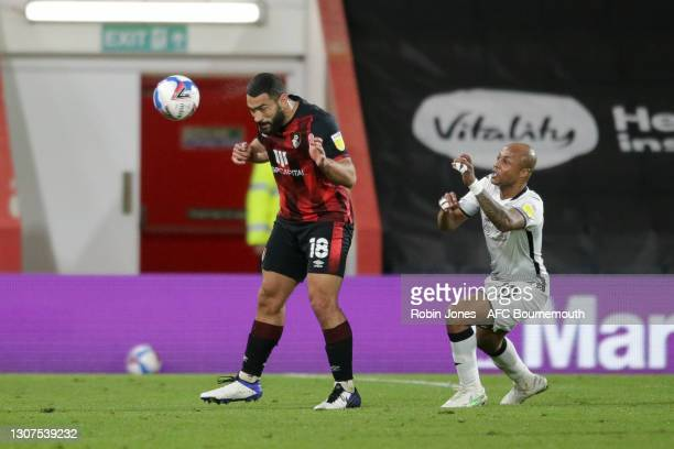 Cameron Carter-Vickers of Bournemouth clears from Andre Ayew of Swansea City during the Sky Bet Championship match between AFC Bournemouth and...