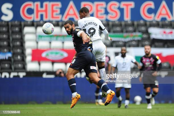 Cameron Carter-Vickers of Luton Town under pressure from Rhian Brewster of Swansea City during the Sky Bet Championship match between Swansea City...