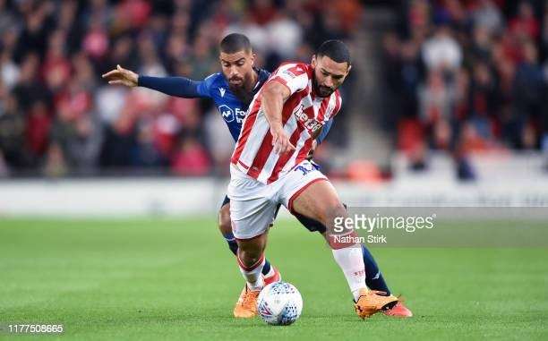Cameron Carter-Vickers of Stoke City and Lewis Grabban of Nottingham Forest in action during the Sky Bet Championship match between Stoke City and...