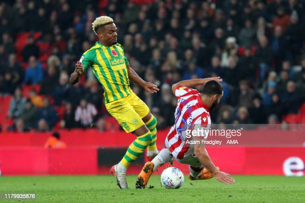 Cameron CarterVickers of Stoke City fouls Grady Diangana of West Bromwich Albion and gives away a penalty during the Sky Bet Championship match...