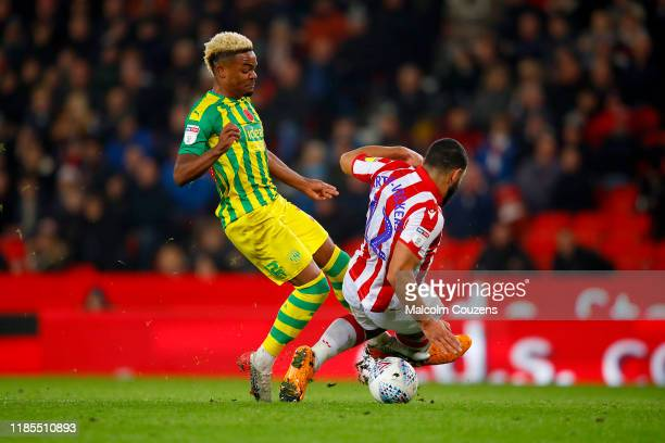 Cameron CarterVickers of Stoke City fouls Grady Diangana of West Bromwich Albion to concede a penalty during the Sky Bet Championship match between...