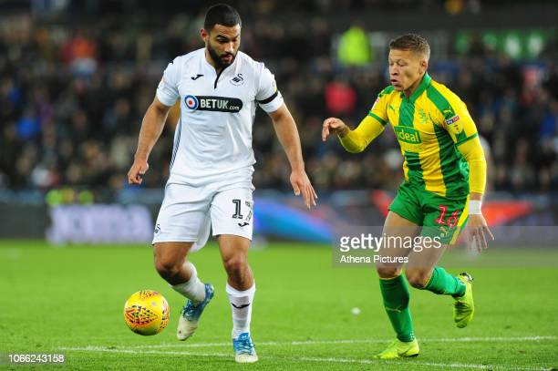Cameron Carter-Vickers of Swansea City battles with Dwight Gayle of West Bromwich Albion during the Sky Bet Championship match between Swansea City...