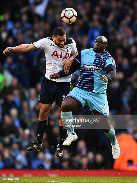 Cameron CarterVickers of Tottenham Hotspur and Adebayo Akinfenwa of Wycombe Wanderers compete for the ball during the Emirates FA Cup Fourth Round...