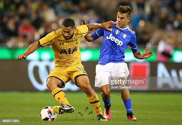 Cameron CarterVickers of Tottenham Hotspur and Paulo Dybala of Juventus FC compete for the ball during the 2016 International Champions Cup match...