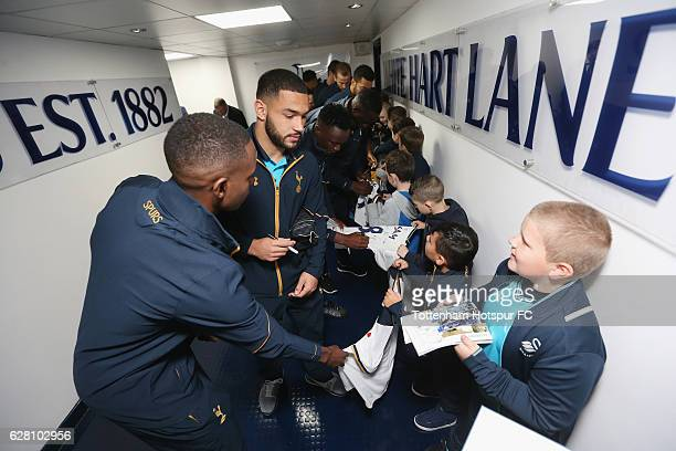 Cameron CarterVickers of Tottenham signs autographs for mascots prior to the Premier League match between Tottenham Hotspur and Swansea City at White...