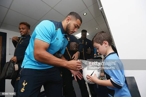 Cameron Carter-Vickers signs autographs for mascots during the EFL Cup Third Round match between Tottenham Hotspur and Gillingham at White Hart Lane...