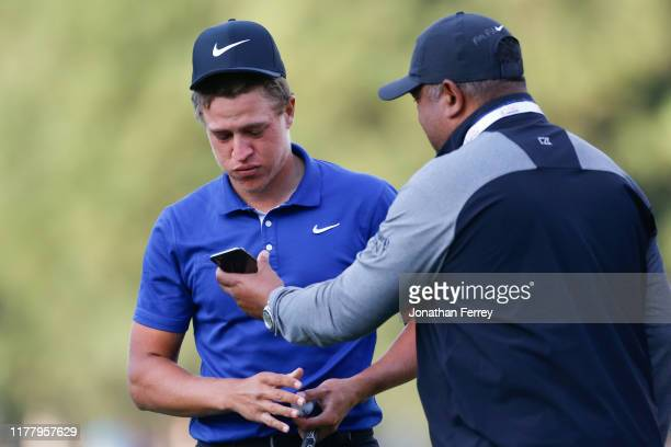 Cameron Champ celebrates with his father, Jeff Champ, and his grandfather on the phone, after winning the final round of the Safeway Open at the...