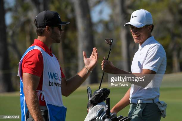 Cameron Champ high fives his caddy following a made putt on the 18th green during the third round of the Webcom Tour's Savannah Golf Championship at...