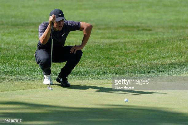 Cameron Champ of the United States lines up a putt on the 18th green during the first round of the BMW Championship on the North Course at Olympia...