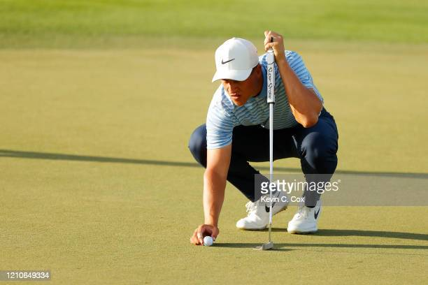 Cameron Champ of the United States lines up a putt on the eighth green during the first round of the Arnold Palmer Invitational Presented by...