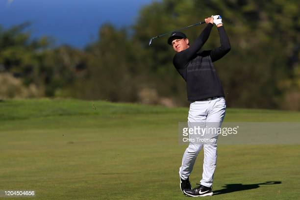 Cameron Champ of the United States plays a shot during the first round of the ATT Pebble Beach ProAm at Monterey Peninsula Country Club on February...