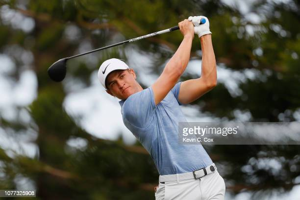 Cameron Champ of the United States plays his shot from the 15th tee during the second round of the Sentry Tournament of Champions at the Plantation...