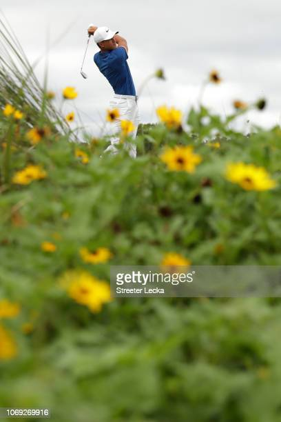 Cameron Champ of the United States plays his shot from the eighth tee during the final round of the RSM Classic at the Sea Island Golf Club Seaside...