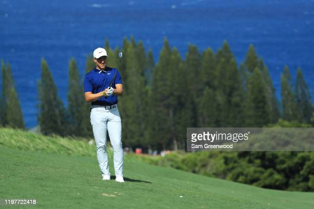 Cameron Champ of the United States prepares to play a shot on the fourth hole during the final round of the Sentry Tournament Of Champions at the...