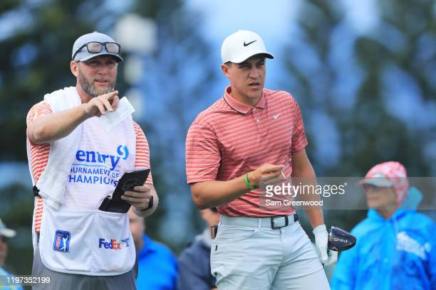 Cameron Champ of the United States talks with his caddie on the third tee during the second round of the Sentry Tournament Of Champions at the...