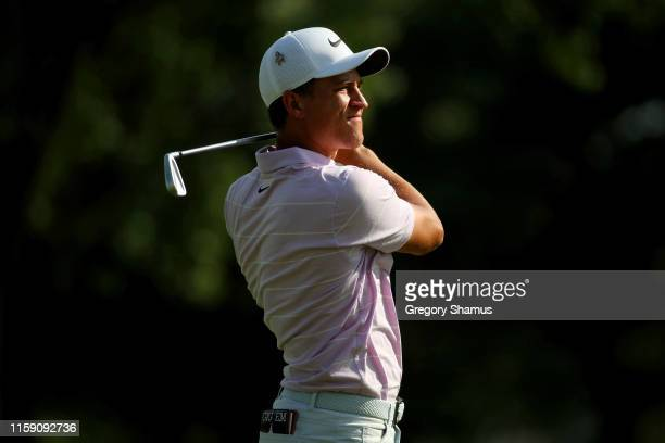 Cameron Champ plays his shot on the 17th hole during round three of the Rocket Mortgage Classic at the Detroit Country Club on June 29 2019 in...