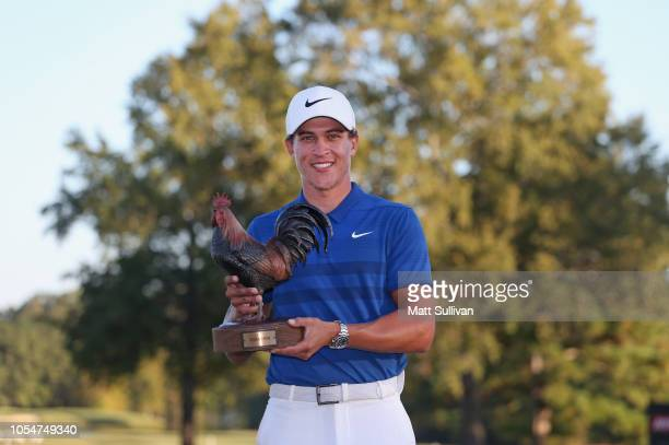 Cameron Champ poses with the trophy after winning the Sanderson Farms Championship at the Country Club of Jackson on October 28 2018 in Jackson...