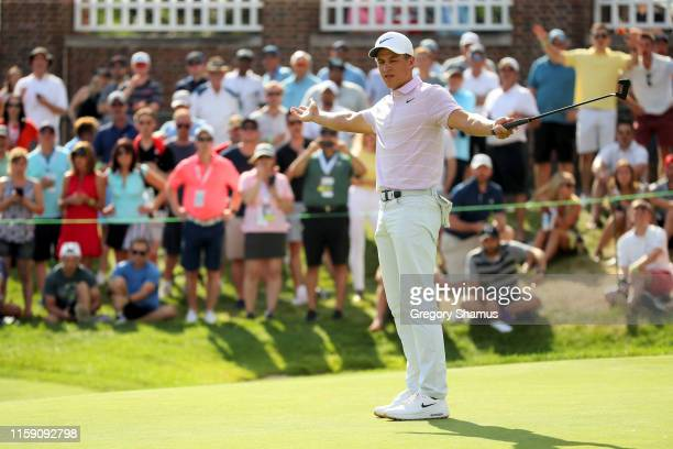 Cameron Champ reacts after making birdie on the 18th green during round three of the Rocket Mortgage Classic at the Detroit Country Club on June 29,...