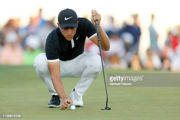 Cameron Champ reacts on the 18th green during the second round of the Waste Management Phoenix Open at TPC Scottsdale on February 01 2019 in...