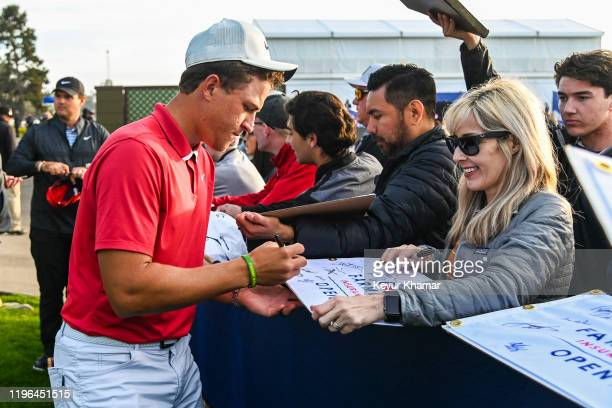 Cameron Champ signs autographs for fans during the third round of the Farmers Insurance Open on Torrey Pines South on January 25 2020 in San Diego...