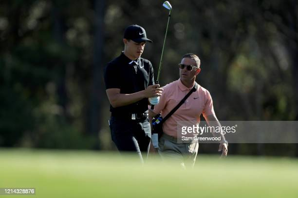 Cameron Champ speaks with his swing coach Sean Foley during a practice round prior to The PLAYERS Championship at the TPC Stadium course on March 11...