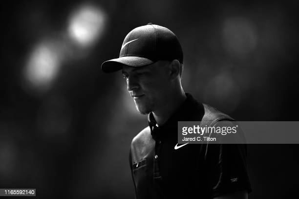 Cameron Champ walks off the 14th green during the first round of the Wyndham Championship at Sedgefield Country Club on August 01 2019 in Greensboro...