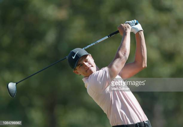 Cameron Champ watches his tee shot on the fifth hole during the third round of the Sanderson Farms Championship at the Country Club of Jackson on...