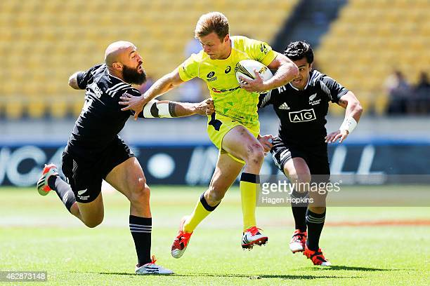 Cameron Clark of Australia beats the tackle of D J Forbes of New Zealand during the match between New Zealand and Australia in the 2015 Wellington...