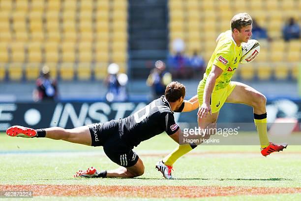 Cameron Clark of Australia beats the tackle of Joe Webber of New Zealand during the match between New Zealand and Australia in the 2015 Wellington...