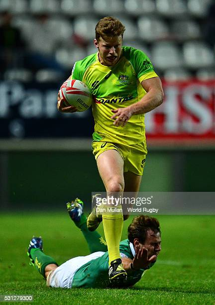 Cameron Clark of Australia makes a break past Lucas Muller of Brazil to score a try during the pool round match between Australia and Brazil on day...