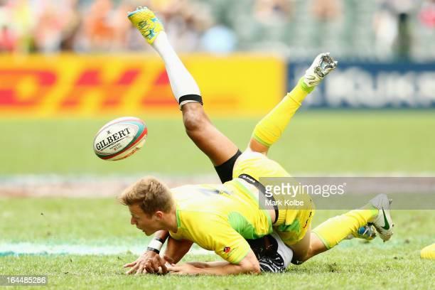 Cameron Clark of Australia tackles Ilai Tinai of Fiji during the cup quarter final match between Australia and Fiji on day three of the 2013 Hong...