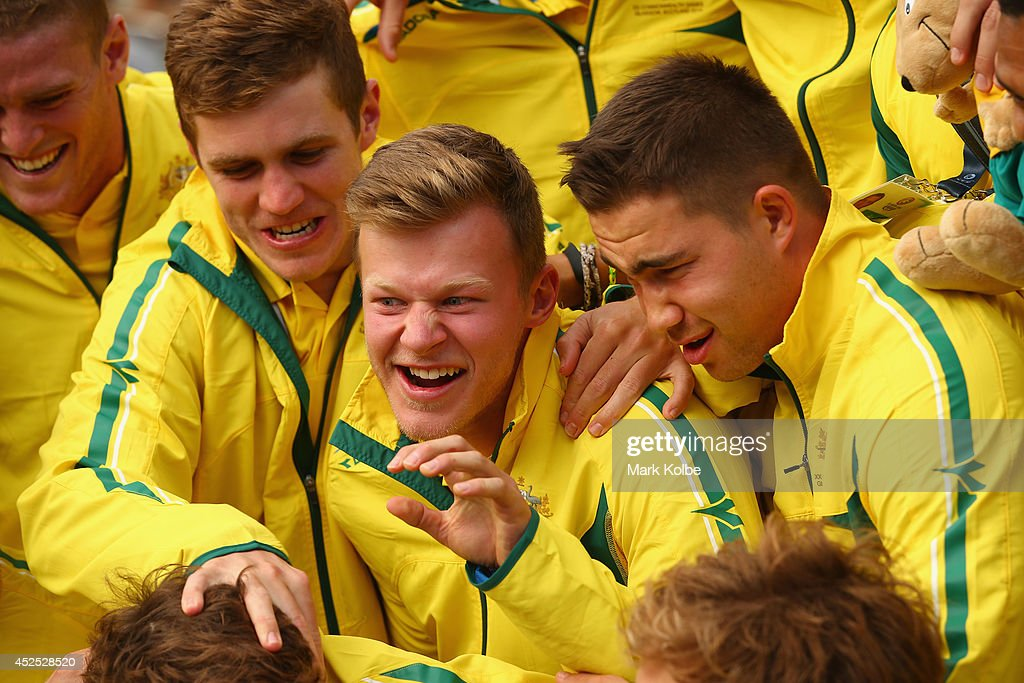 Cameron Clark of the Australian men's sevens rugby team shares a laugh with his team as they pose before the Australian Commonwealth Games official team reception at the Kelvin Grove Art Gallery and Museum on July 21, 2014 in Glasgow, Scotland.