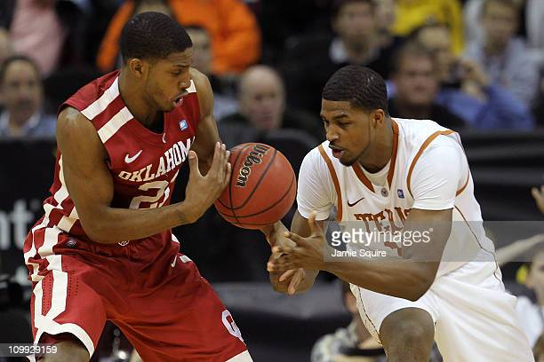 Cameron Clark of the Oklahoma Sooners and Tristan Thompson of the Texas Longhorns look to recover a loose ball during their quarterfinal game in the...