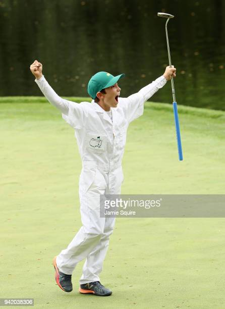 Cameron Cole Kuchar, son of Matt Kuchar of the United States celebrates holing-out on a green during the Par 3 Contest prior to the start of the 2018...