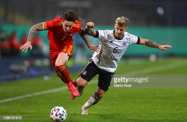 Cameron Coxe of Wales is challenged by Niklas Dorsch of Germany during the UEFA Euro Under 21 Qualifier match between Germany U21 and Wales U21 at...