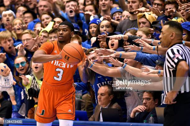 Cameron Crazies and fans of the Duke Blue Devils taunt Anthony Lawrence II of the Miami Hurricanes in the first half at Cameron Indoor Stadium on...